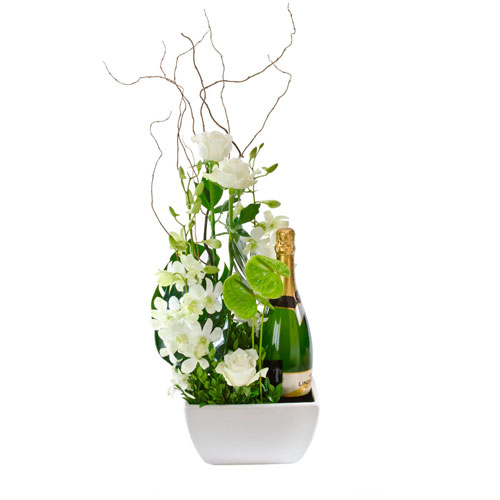 Flower arrangement with bottle of wine