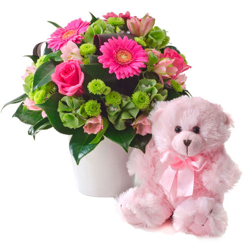 Pink Floral arrangement with teddy bear