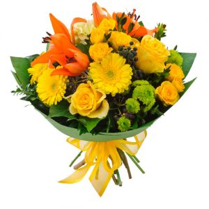 Yellow and orange flowers in a clear vase