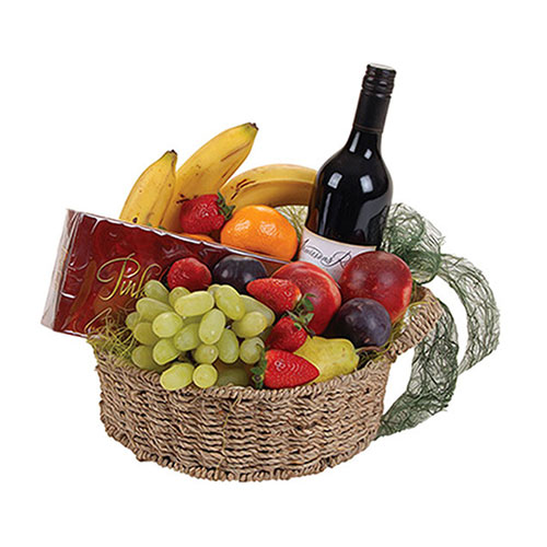 Bottle of wine, fruit and chocolate