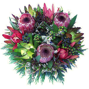 Sympathy wreath containing assorted native flowers and foliage