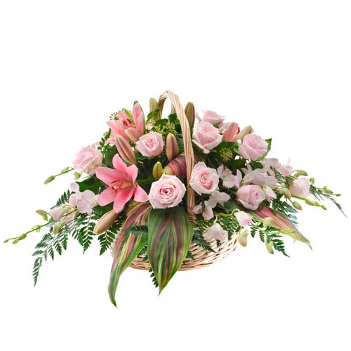 Basket filled with pastel coloured flowers