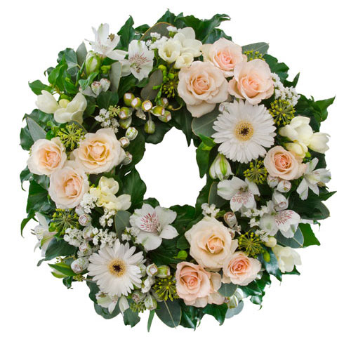 Pastel, pink and white cluster wreath suitable for service.