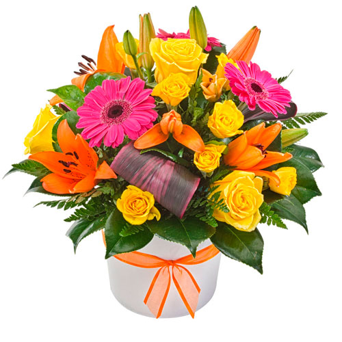 Bright flower arrangement in ceramic container